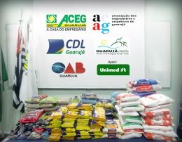 Entrega de alimentos arrecadados no Café Empresarial realizado dia 30/03/2017